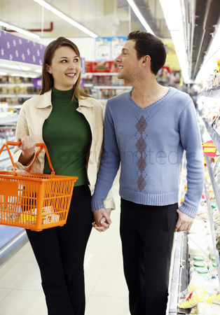 Having fun : Couple shopping in the supermarket