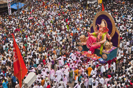 God : Crowd at religious procession during ganpati visarjan ceremony  mumbai  maharashtra  india