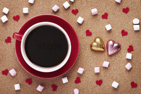 Food  beverage : Cup of coffee with marshmallows and heart shaped chocolates