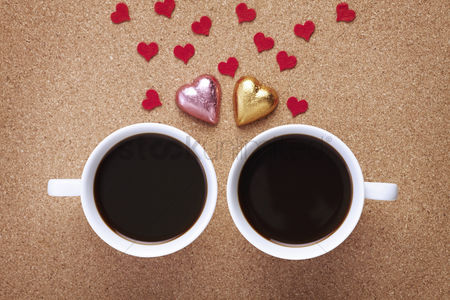 Love : Cup of coffees with heart shapes chocolates