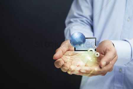Conceptual : Cupped hands presenting computer infographic elements
