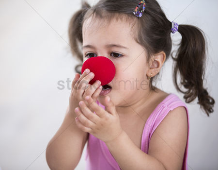 Czech republic : Cute girl wearing clown nose at home