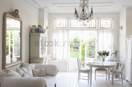 Interior : Daybed with cushions and glass chandelier in white home interior