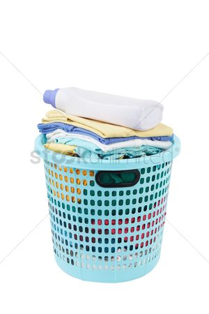 Tidy : Detergent bottle on a laundry basket