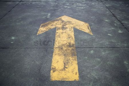 Abstract : Directional arrow painted on the street  close-up