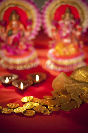 God : Diwali oil lamps and coins with idols of lakshmi and ganesh during diwali festival
