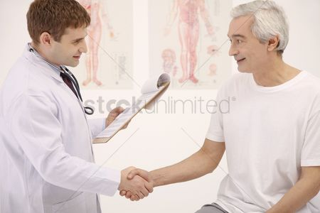 Two people : Doctor and patient shaking hands