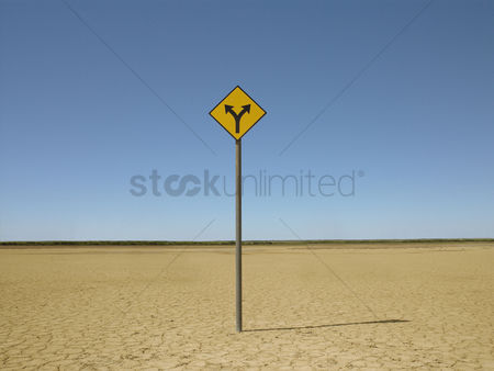 Remote : Double arrow sign on arid landscape