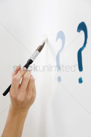 Wondering : Drawing question mark on white wall
