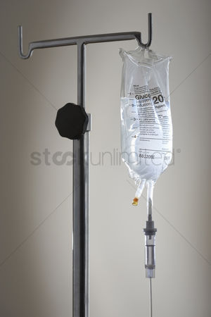 Medication : Drip bag on stand against white background