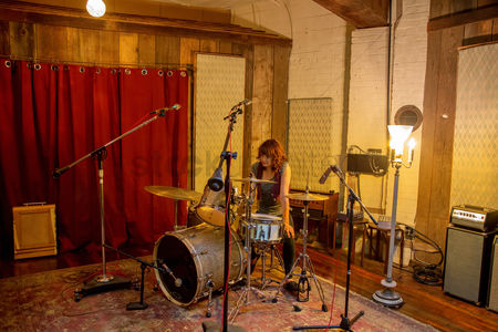 Excited : Drummer on set in recording studio