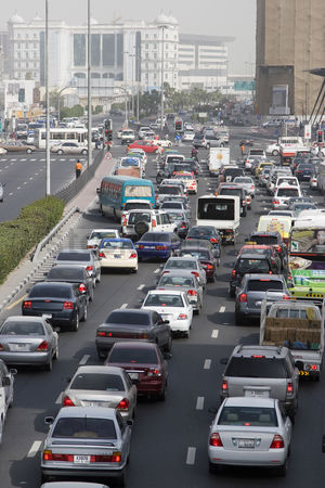 Car : Dubai uae traffic is backed up on al-maktoum road in deira  traffic in dubai during morning