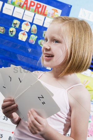 School children : Elementary student with alphabet flash cards