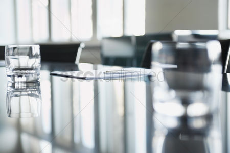 Interior : Empty glasses on conference room table