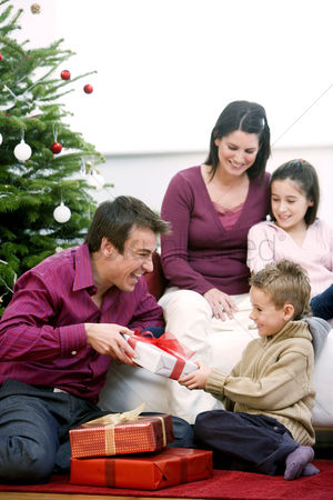 Comfy : Family gathering around the christmas tree