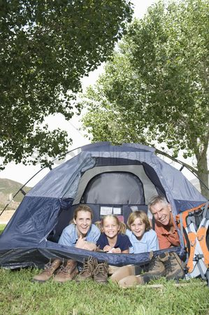 Pitch : Family of four smiling from a tent