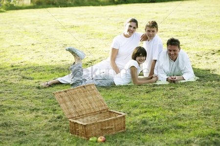 Grass : Family picnicking in the park