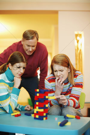 Careful : Family playing block game at home