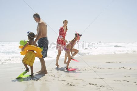 Closeness : Family playing on beach