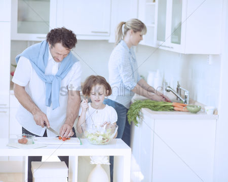 Offspring : Family preparing healthy meal in kitchen