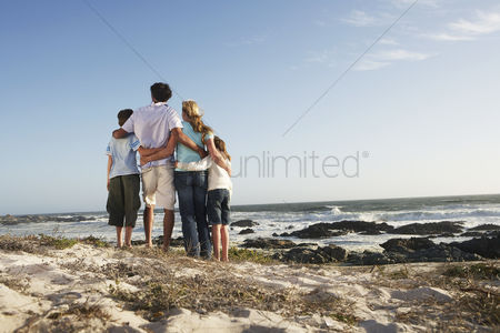 Two people : Family standing together on beach back view