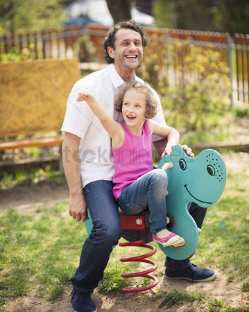 Czech republic : Father and daughter on playground spring rider