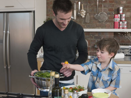Offspring : Father and son preparing salad