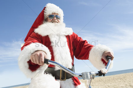 Jacket : Father christmas cycles along beach front