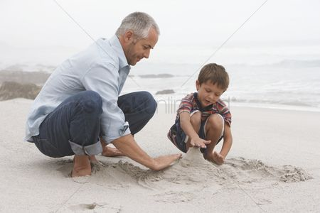 Relationship : Father playing with son on beach