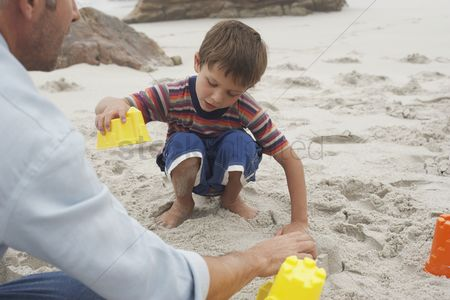 Children playing : Father playing with son on beach