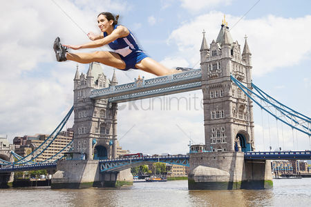 British ethnicity : Female athlete hurdling tower bridge