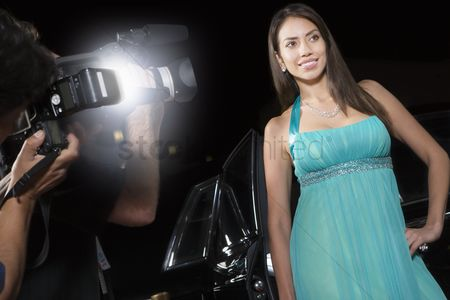 Posing : Female celebrity being photographed at media event