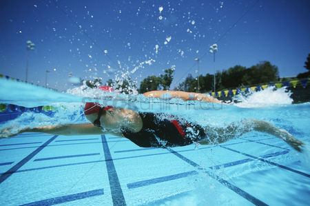 Swimmer : Female swimmer in pool surface view