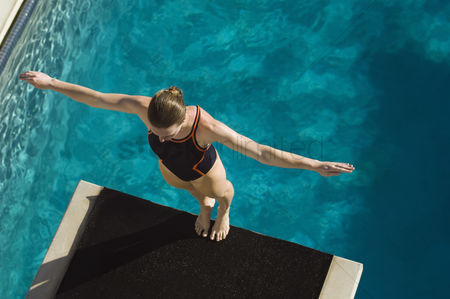 Diving : Female swimmer standing on diving board
