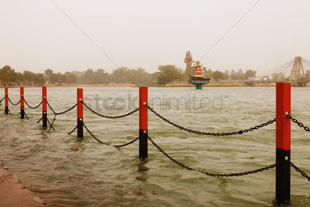 God : Fence and the statue of goddess ganga in a river  ganges river  haridwar  uttarakhand  india