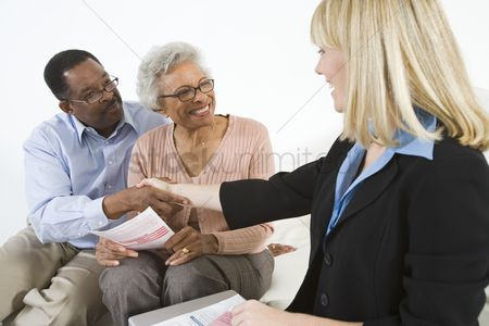 Husband : Financial advisor assisting senior couple