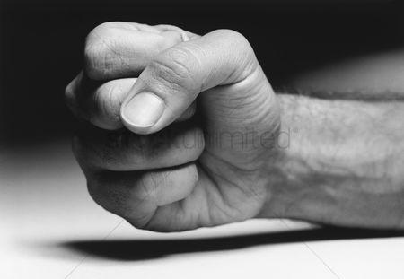 https://images.cdn2.stockunlimited.net/thumb450/fist-close-up--b-w_1885352.jpg