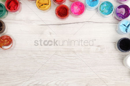 Paint brush : Flat lay of poster paints on wooden background
