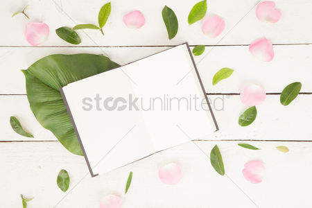Notebook : Flatlay of background with pink rose and book