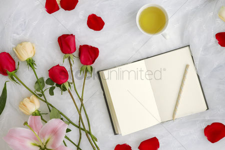 Notebook : Flatlay of white background with flowers