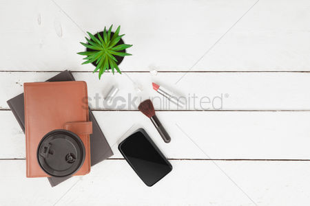 Flatlay : Flatlay of white background with makeup accessories