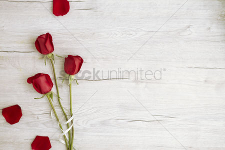 Conceptual : Flatlay of wooden background with roses
