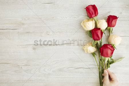 Background : Flatlay of wooden background with roses
