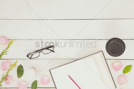 Blank : Flatlay with petals and journal