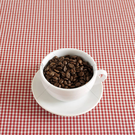 Food  beverage : Fresh espresso coffee beans in a cappuccino cup