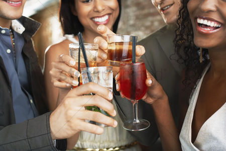 Appearance : Friends toasting  in bar close up on glasses