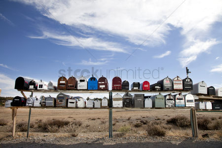 On the road : Front view of rows of mailboxes in desert