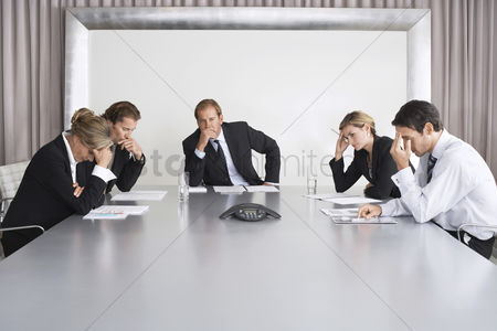 Spacious : Frustrated businesspeople listening to conference call