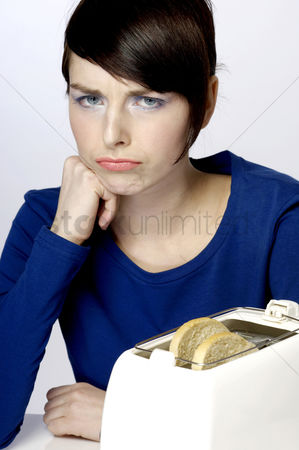 Mad : Frustrated woman waiting for her toast