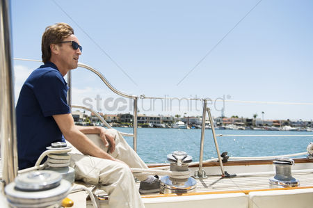 Rope : Full-length side view of man sitting on yacht